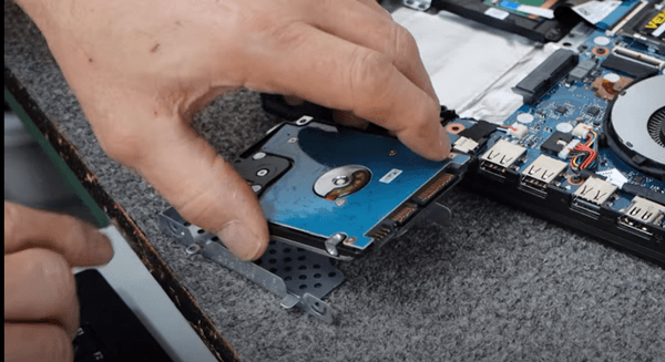 removing the hard drive from its bracket