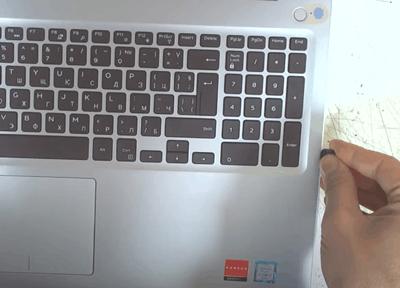 detaching the base panel using a prying tool
