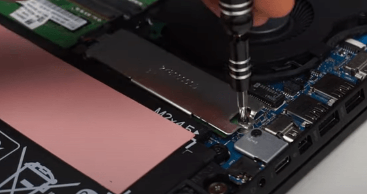 opening the metallic cover from the M.2 port